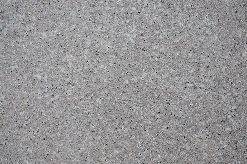 Extreme close up shot of mottled granite slab textured backgrounds