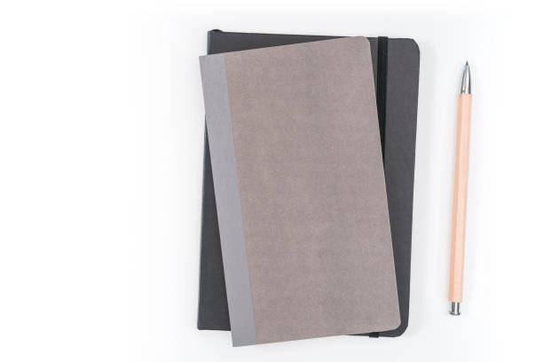 gray notebook on white background with clipping path stock photo