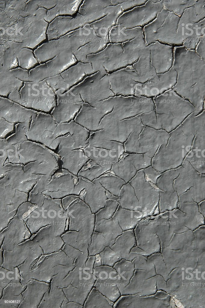 Gray paint cracking and peeling stock photo