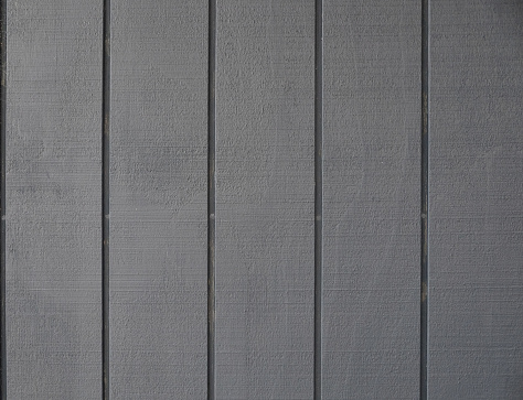 Gray painted wood textured in vertical stripes