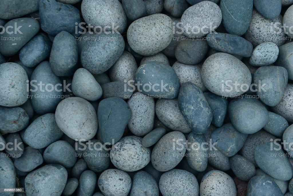 Gray pebble stones background stock photo