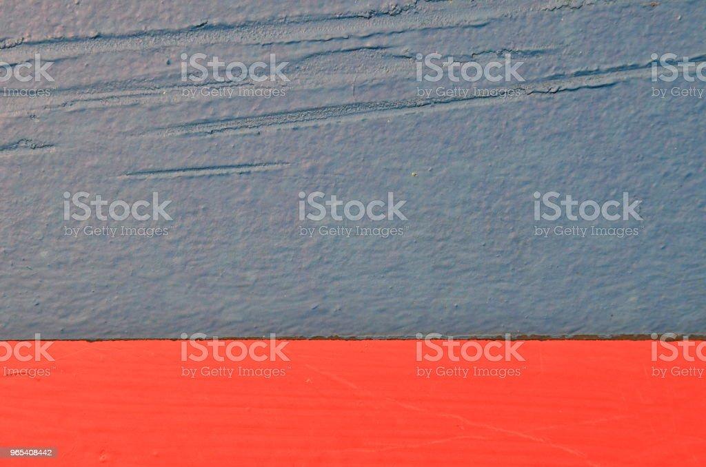 Gray, red, scratched paint background zbiór zdjęć royalty-free