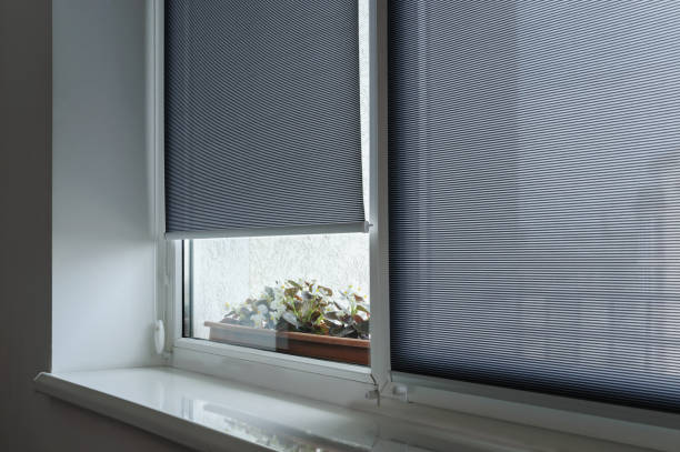 gray roller shutters on the window. - blinds stock pictures, royalty-free photos & images