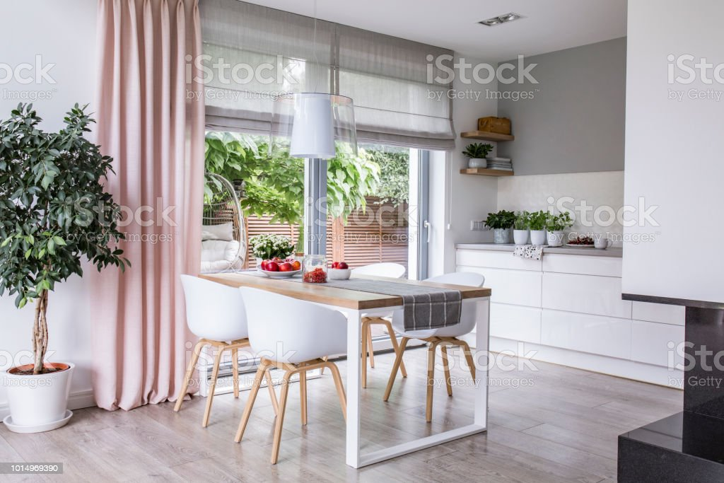 Gray Roman Shades And A Pink Curtain On Big Glass Windows In ...