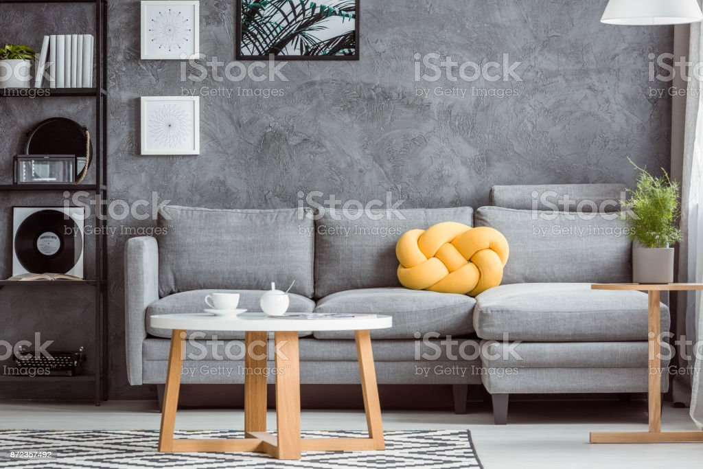 Gray room with yellow accent stock photo