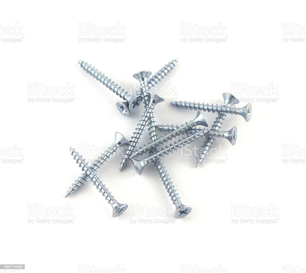Gray screws on white background closeup stock photo