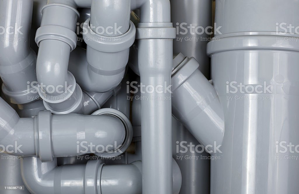 Gray sewer pipes intertwining with each other stock photo
