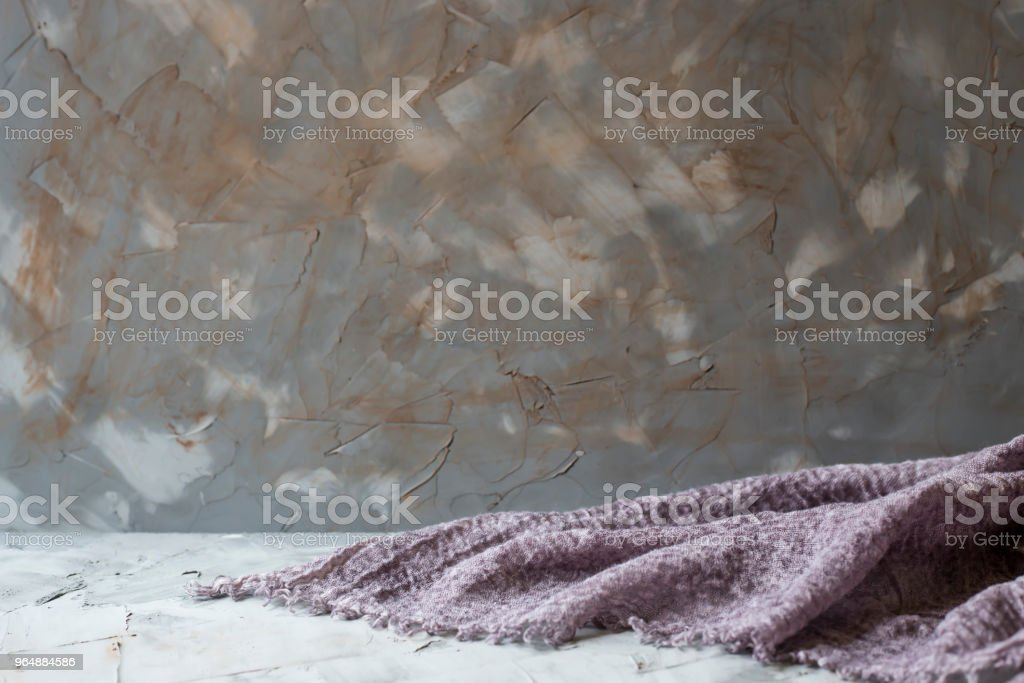 Gray shabby concrete background with purple board on the table. Copyspace royalty-free stock photo