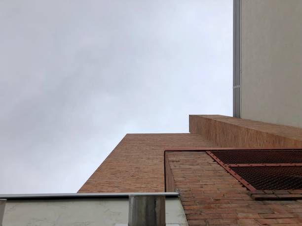 Gray Skies Loom Above an Old Brick Building stock photo