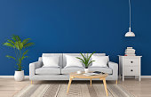 Gray sofa in classic blue living room for mockup, 3D rendering