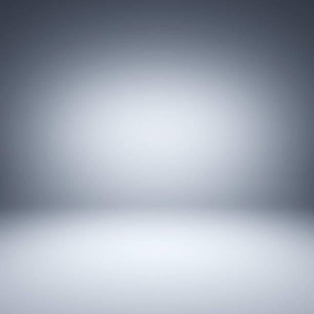 Gray spotlight background. Empty gray studio. stock photo
