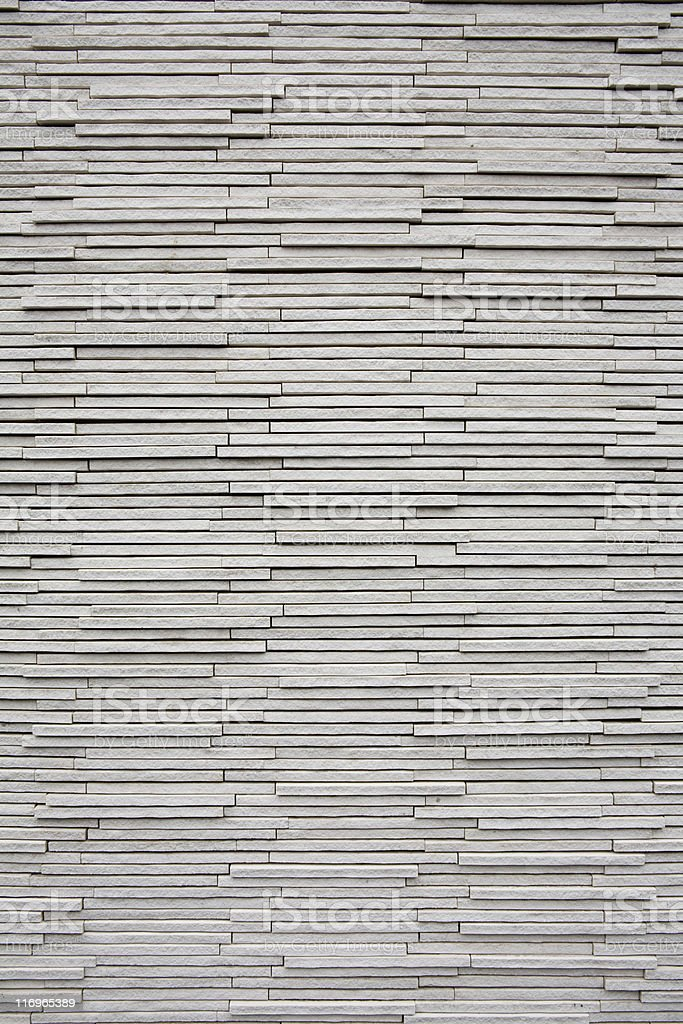 Gray stacked stone wall background texture, pattern and backdrop royalty-free stock photo