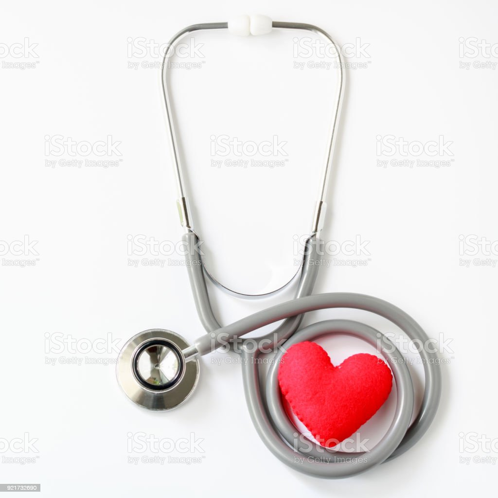 Gray stethoscope with red heart isolated on white background. Medical instruments used to hear sounds within the patient's body. Top view. stock photo