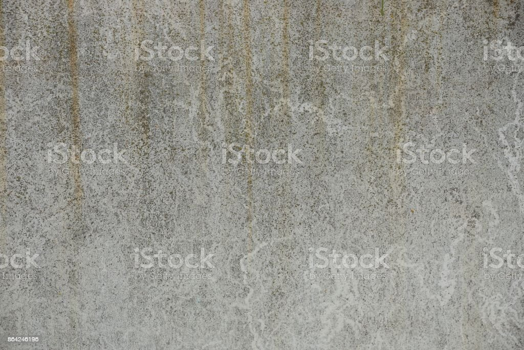 A gray stone texture from a part of a grated concrete wall royalty-free stock photo