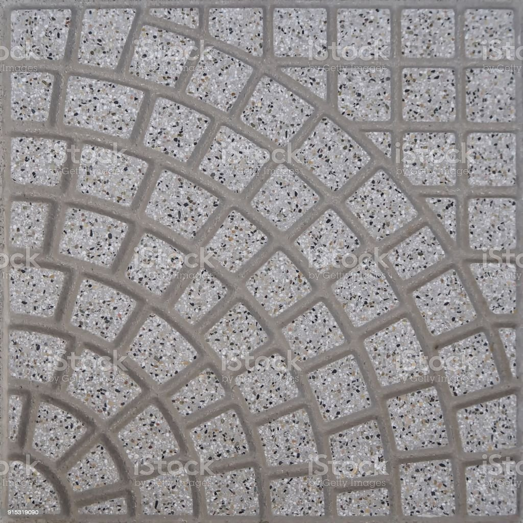 Gray stone tile for exterior made by quadrilaterals forming a fan shape pattern stock photo