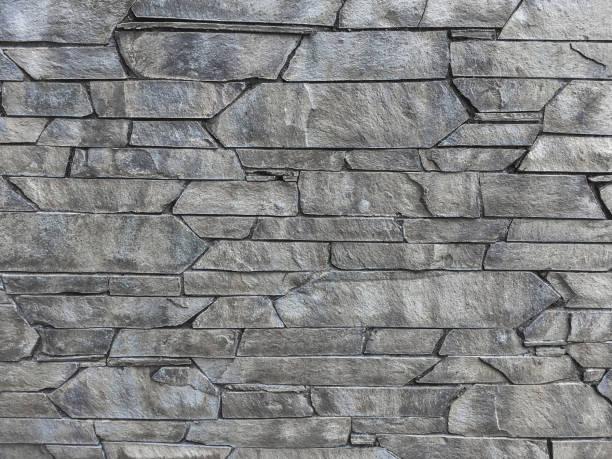 Gray stone wall cladding stock photo