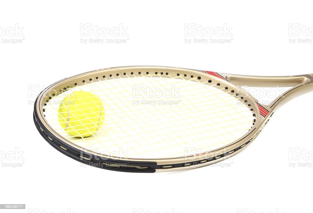Gray tennis racket and yellow ball royalty-free stock photo