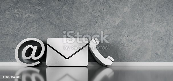istock 3D gray text shape of communication symbols against wall with copyspace 1161334946