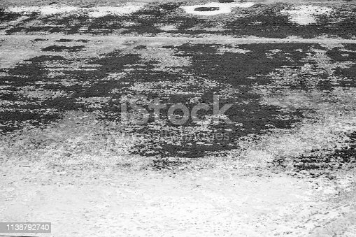 639394370istockphoto gray texture of Grass growing through snow spring 1138792740