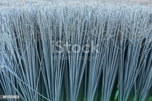istock gray texture of long bristles on the brush 981003804
