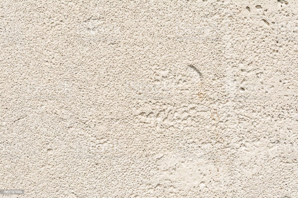 gray texture of the porous surface of the concrete wall of the