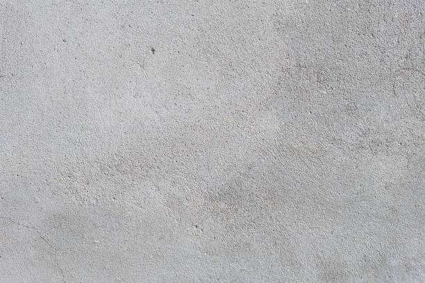 Gray textured cement wall background with fine concrete chips. stock photo