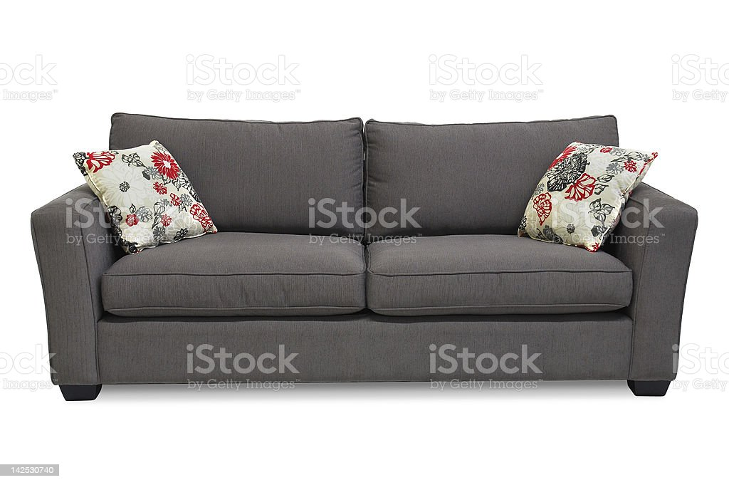 Gray upholstered loveseat sofa two throw pillows stock photo