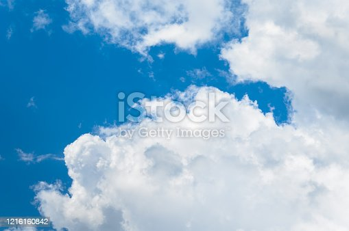 Gray white clouds. Clouds of thunderclouds on a blue sky. Summer day.