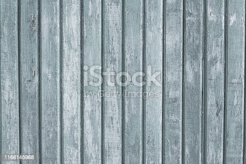 Gray wood vertical planks in rustic style. Grunge background of construction material. Wooden texture board. Pattern of grey old floor. Vintage white pine for design. Light wooden dirty wall surface