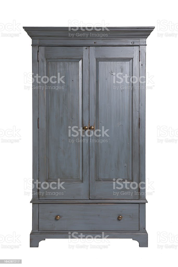 A gray wooden wardrobe with drawers stock photo