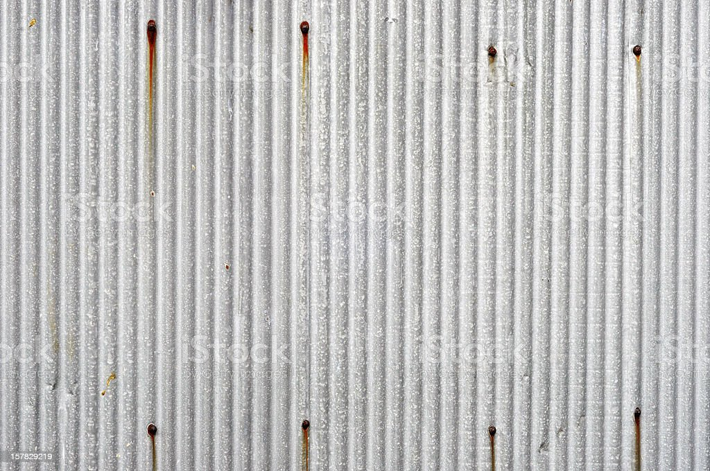 Gray zinc with thin stripes and 8 brown, vertical markings stock photo