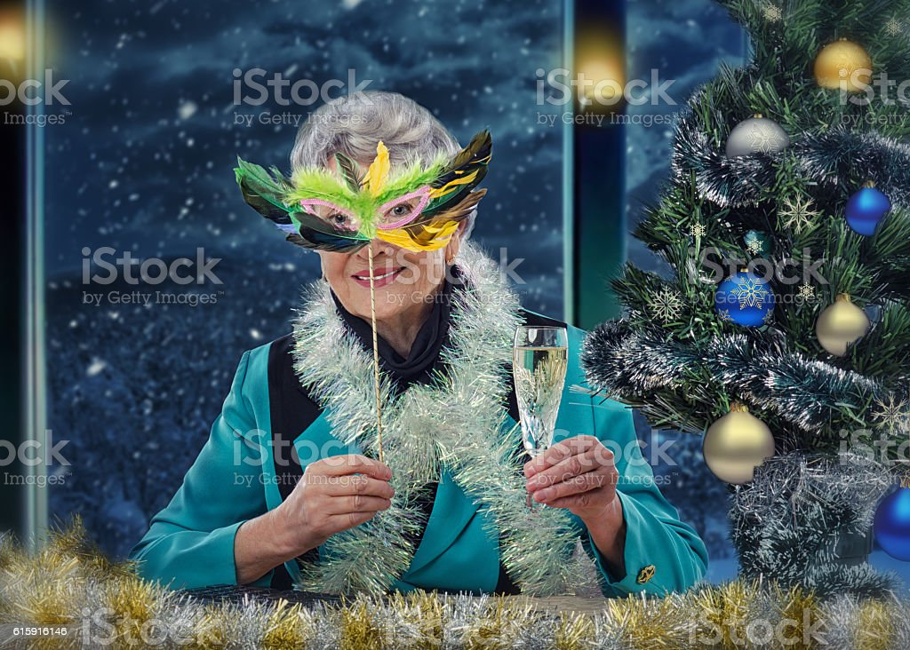 Gray-haired old woman in mask wishes a Merry Christmas stock photo