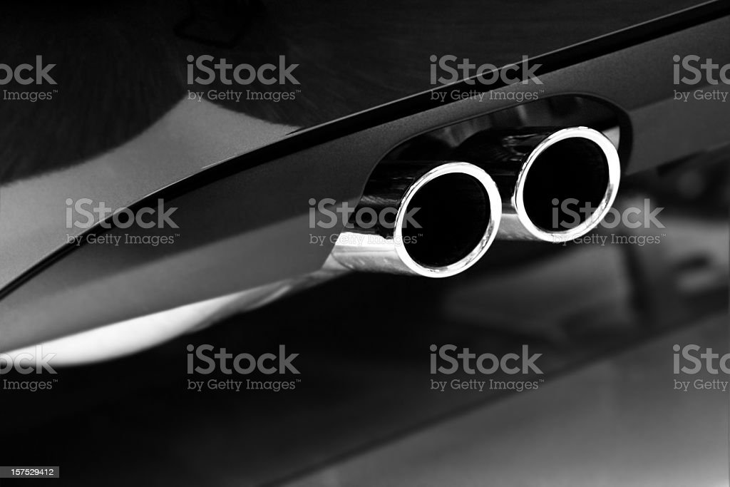 Grayscale photo of car exhaust pipes stock photo