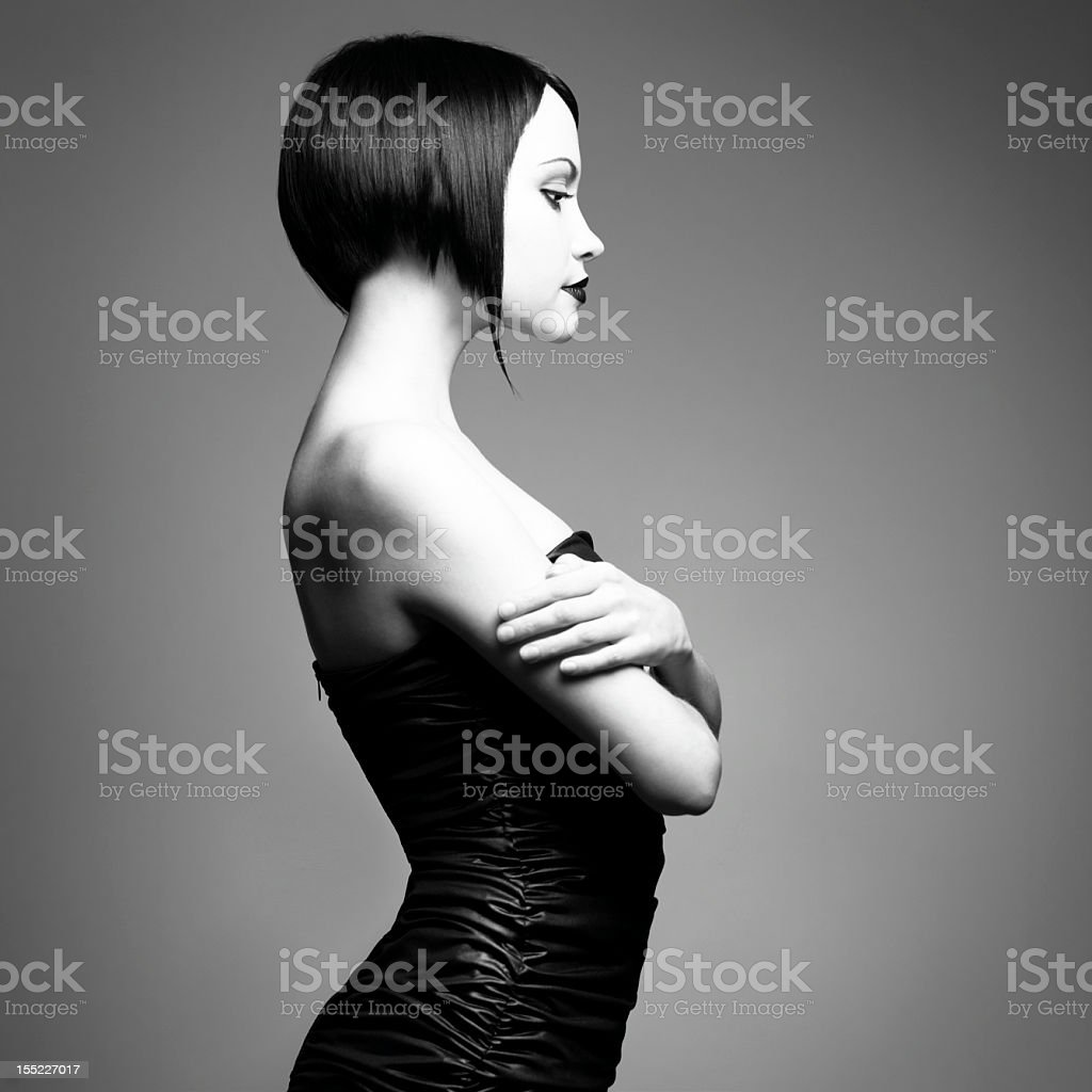 Grayscale portrait of stylish woman with slick angled bob royalty-free stock photo