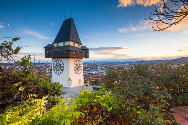 Grazer Uhrturm bei Sonnenuntergang, Graz, Steiermark, Österreich – Foto