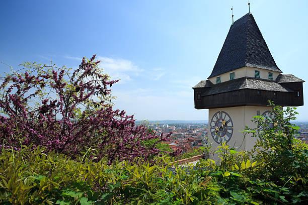 grazer uhrturm, clock tower - stadt graz stock-fotos und bilder