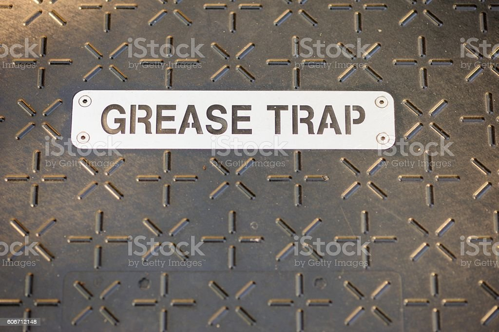 Grease trap sign on cover stock photo