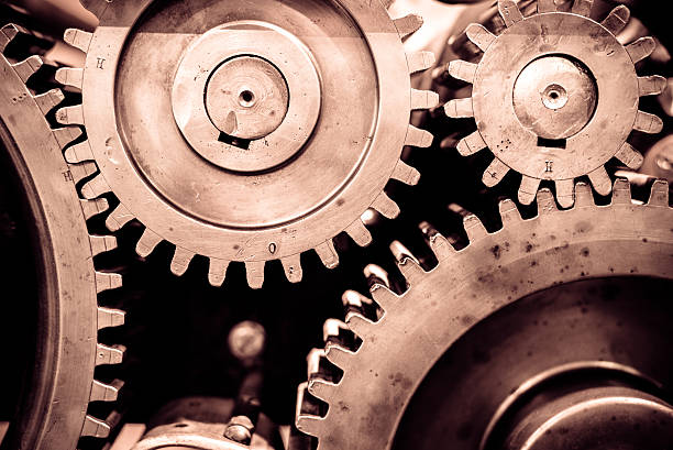greasy gears in the machine. - cog stock photos and pictures