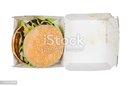 A greasy hamburger isolated on white.