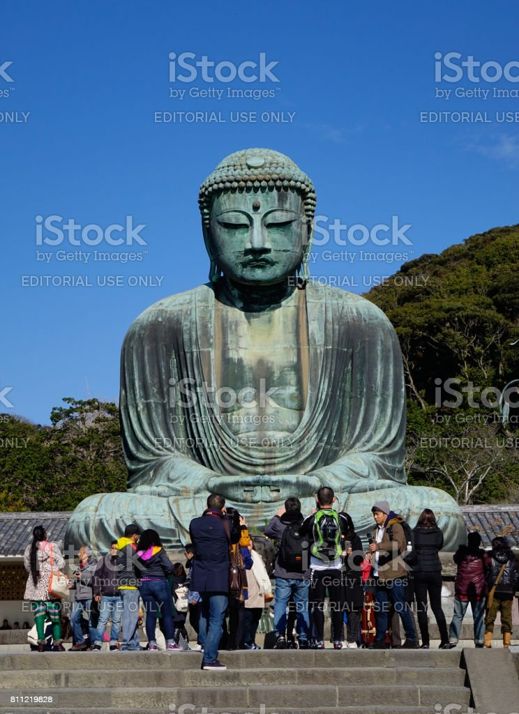 Great Amida Buddha and tourists in Japan stock photo