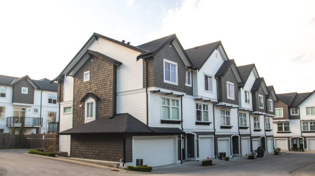 Great and comfortable neighborhood. A row of townhouses at the empty street. stock photo