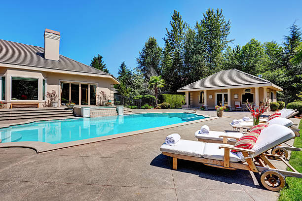 Great backyard with swimming pool. American Suburban luxury house Great backyard with swimming pool and lounge chairs in American Suburban luxury house. Northwest, USA backyard pool stock pictures, royalty-free photos & images