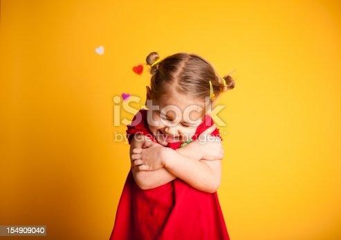 istock Great Big Valentine Hug, Cute Girl Hugging Herself 154909040