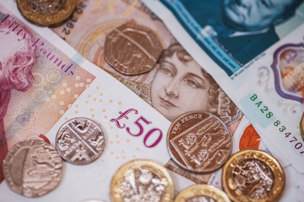 Great Britain Pound (GBP) coins and banknotes stock photo