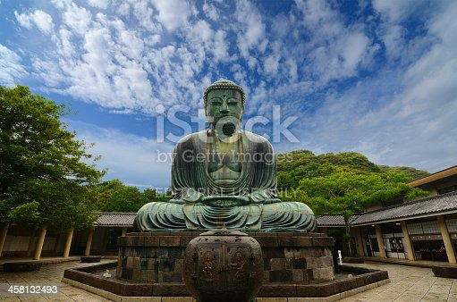 Kamakura, Japan - July 19, 2011: Originally housed in a hall that was destroyed twice in the 14th Century, the great Buddha at Kotoku-in Temple dates from 1252 during the Kamakura Period.