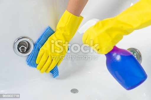 istock Great concept of domestic cleaning, hand with glove cleaning bath. 955902718