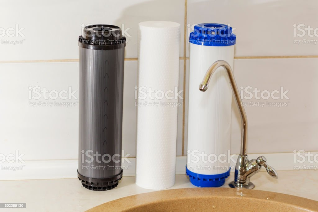 Great filters to purify your drinking water an image isolated in the kitchen interior stock photo