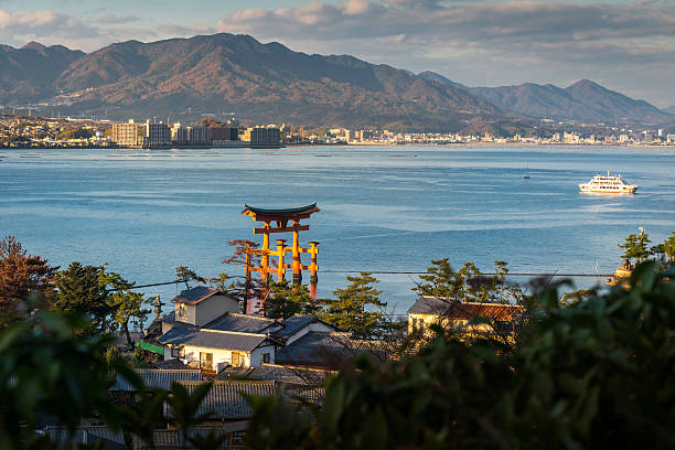 Great floating gate (O-Torii) and Hiroshima city view from Miyaj High Angle View of Great floating gate (O-Torii) and Hiroshima city view from Miyajima Island, Japan miyajima stock pictures, royalty-free photos & images