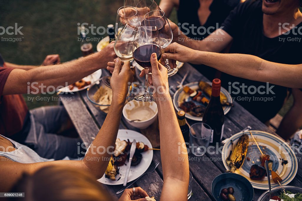 Great food and wine and friends to enjoy it all stock photo