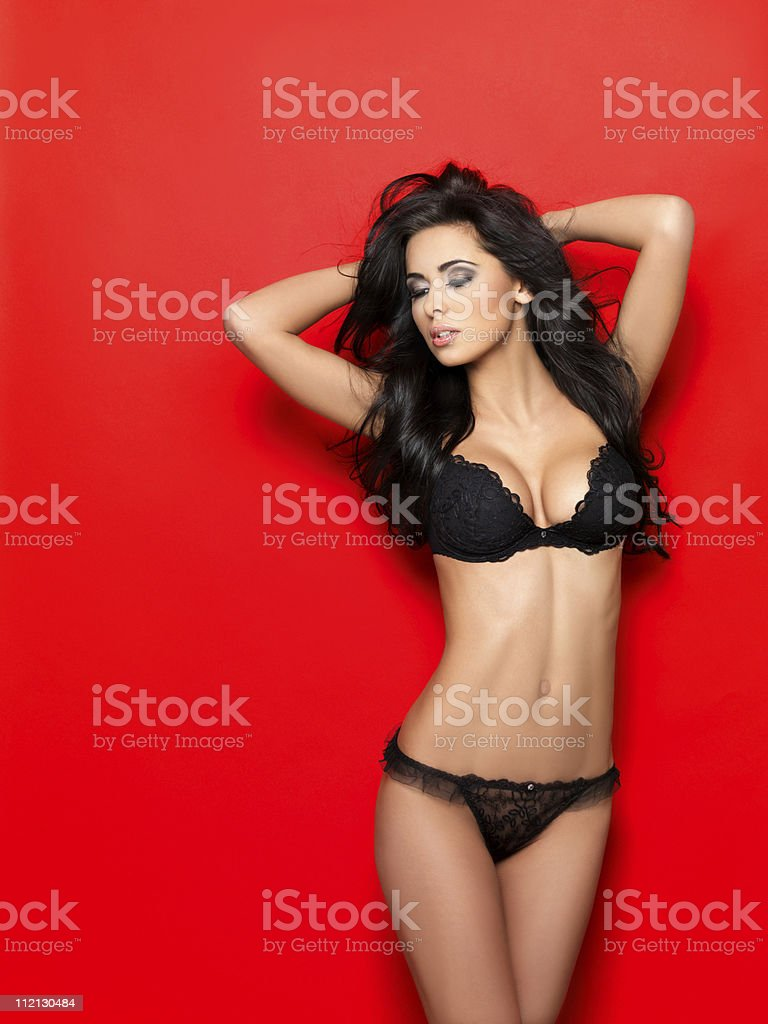 Great girl in beautiful black lingerie stock photo